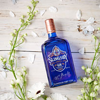 Lime with bottle of Slingsby Gin