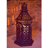 Add an exotic accent to the garden with this durable brushed painted steel contruction lantern to create delightful pockets of light. Candles not incl