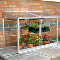 4 long half wall frame with 3mm toughened safety glass, including 1 wide and 1 narrow seed tray shelf. This small greenhouse is designed to fit agains