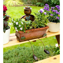 A truly charming and decorative window box. The delightful character of Karl will hold your flower box and watch over the flowers growing within. Idea