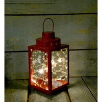 Metal lantern with eight warm white LEDs. 13 x12 x 24cm, supplied as a set of two, 2 x AA batteries required (not included). Designs vary.