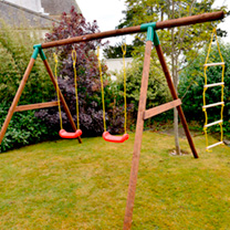This wooden play system will provide hours of outdoor fun for children! The durable frame contains two swing seats and a rope ladder. All Little Tikes